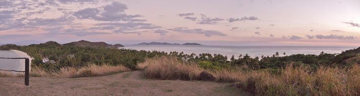 Sunset on Mana Island, Fiji. Taken from Lookout Point towards to the resort and Malolo Island in the background - by Jon Reid