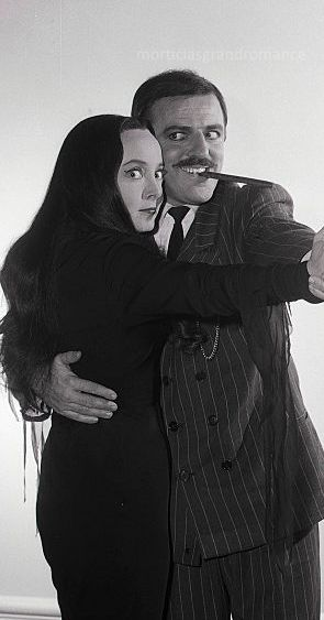 Carolyn Jones as Morticia and John Astin as Gomez in The Addams Family