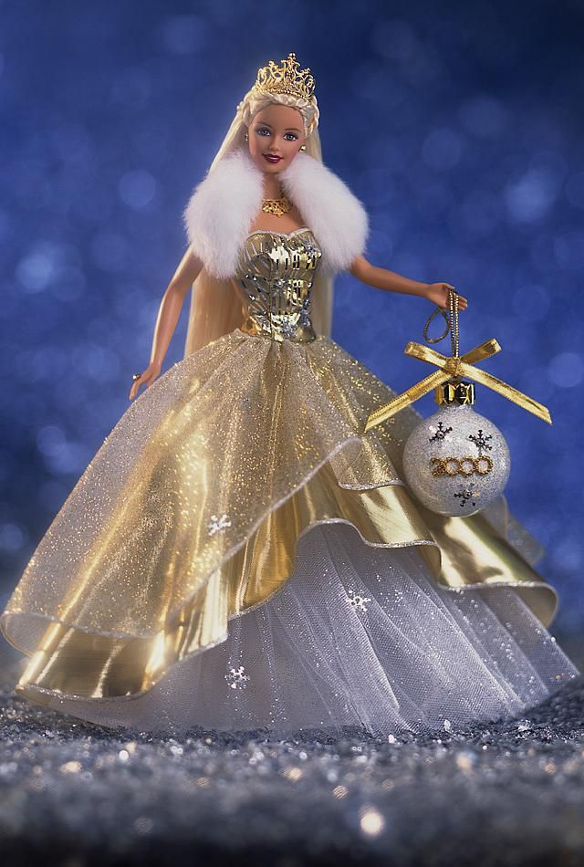 My FAVORITE Barbie in my collection. <3 Hope she's worth some big $$ some day. 2000 Celebration Barbie.