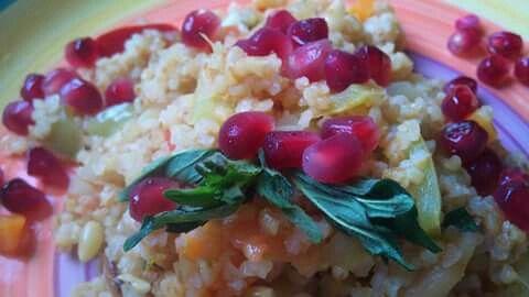 Salat bulgur (barboiled broken wheat) in a wattermill&pomegranate
