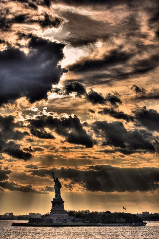 NYC. Liberty Statue in a dramatic skyscape