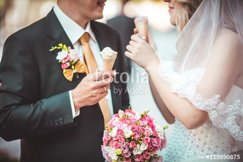 """Download the royalty-free photo """"Beautiful young wedding couple enjoying ice cream"""" created by nataliakabliuk at the lowest price on Fotolia.com. Browse our cheap image bank online to find the perfect stock photo for your marketing projects!"""