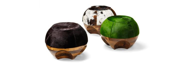 New Objectivity Stool  Inspiring new varieties of our popular ottoman.  The combination of a turned American black walnut base and a top crafted by our master saddler equals sculptural, functional fun.  Built by hand in England.   Dimensions Height:400mm Diameter :530mm