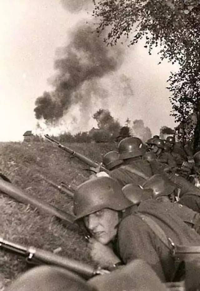 BAPTISM OF FIRE German soldiers prepare to advance on enemy positions, some possibly for the first time. September 1939