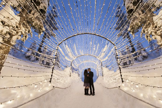 portrait of the bride and groom under the light walk Christmas tunnel in Grouse mountain by Vancouver intimate wedding photographer THIS IS IT STUDIOS