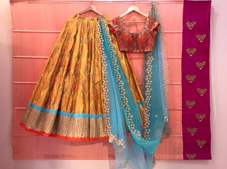 SC-L1200: mustard yellow Ikath lehenga and orange blouse with hand embroidered dupatta!!!!We can customize the colour   size as per your requirement.To order please call/ WhatsApp on 9949944178 or mail us at issadesignerstudio@gmail.com  25 March 2017