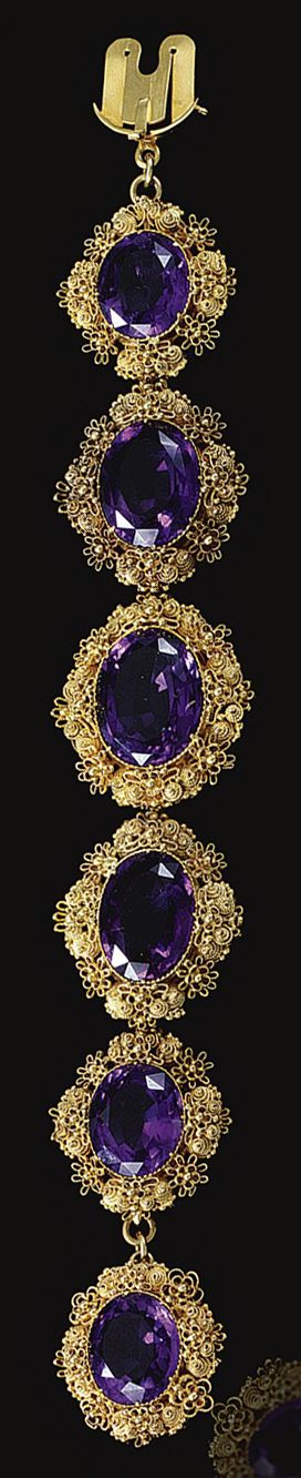 GOLD CANNETILLE AND AMETHYST BRACELET, 1820S.  Designed as a graduation of six oval amethyst each within a gold cannetille surround,    length approximately 170mm, later fitted case by Garrard & Co, 112 Regent Street, W1.