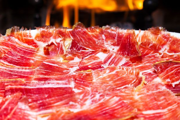 "Healthy Properties of Iberian Ham. The Iberian pig eats grass and acorns in the ""open range"" along with exercise that endow it with a unique and healthy features."