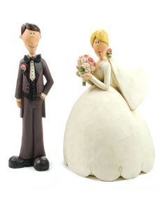 These adorable bride and groom figurines feature a rustic wood finish. Made of resin. <br /> <br />This beautiful wedding figurine may serve as a perfect addition for your guestbook table, or to crown the top of your wedding cake. It also makes a great wedding gift! <br /> <br />Please note: The hair color or colors you have requested may not�.