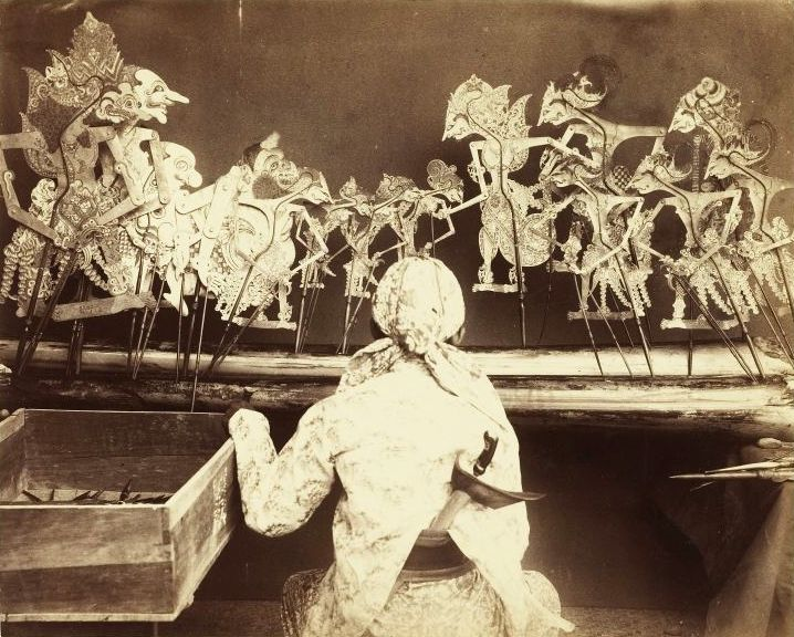 A dalang performing wayang kulit in Java, circa 1890