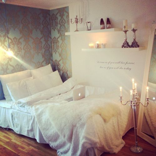 I like the way the bed is set up in the room - and the wallper - all of those candles have got to go tho