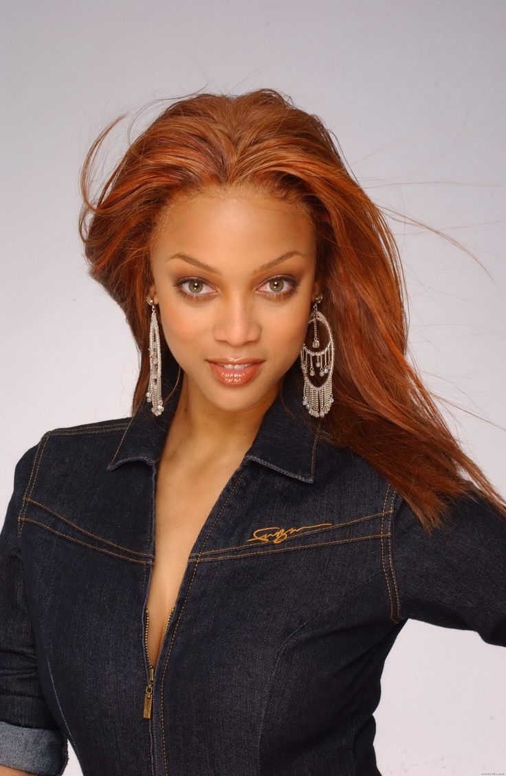Tyra Banks love the red hair! It goes with the jacket so ...