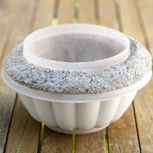 Cast in Stone: DIY Landscape Accent  Making a flower pot mold with old plastic containers!