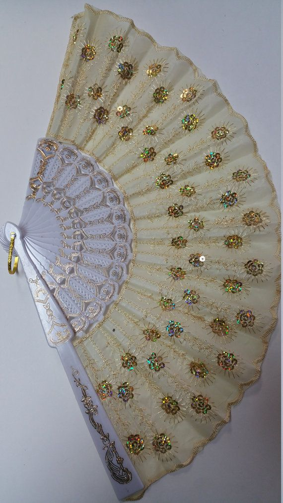 Hand Fan by DollarDazePlus on Etsy ....just like my Dollar Tree fan I bought for $1.00 .....b.....