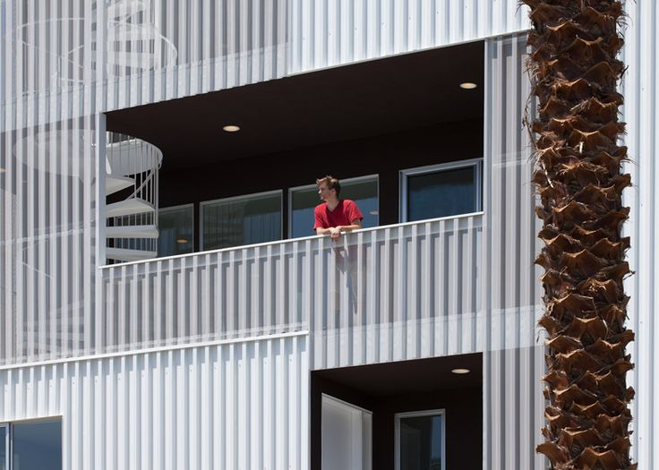 Corrugated cladding with different levels of opacity provides privacy for residents of this apartment block in Los Angeles