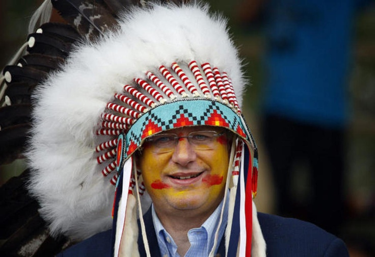 Harper wears a headdress after being made an honourary chief of the Blood tribe during a ceremony in Stand Off, Alberta in 2011.