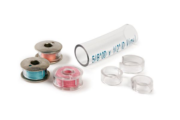 Tame bobbin tales with 7⁄8-inch transparent plastic tubing from the hardware store