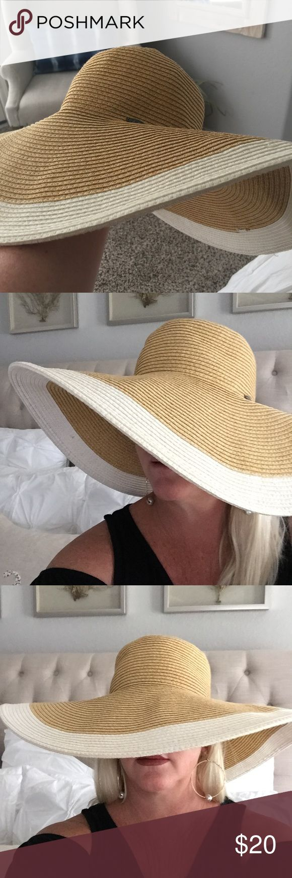 Papillon floppy Sun Hat Floppy Sun Hat.  Perfect for those sunny days by the pool or beach.  This hat has great coverage!  Little bit of make up inside forehead band but other than that it's in good shape. papillon Accessories Hats