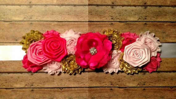 It's a girl pink and gold maternity sash. Maternity belt.