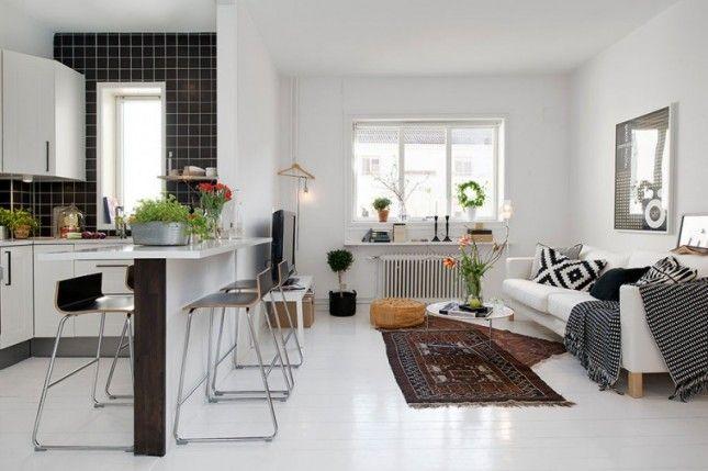 czarno-białe meszkanie,nowoczesny salon z kuchnią, otwarta zabudowa mieszkania, skandynawskie meszkanie,skandynawski styl