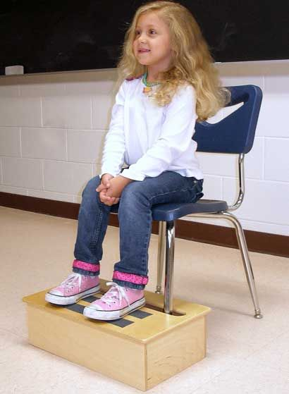 JettStep Footrest - a specialized footrest that is easily anchored to any standard elementary school-sized chair allowing the student to sit with proper posture and alignment.
