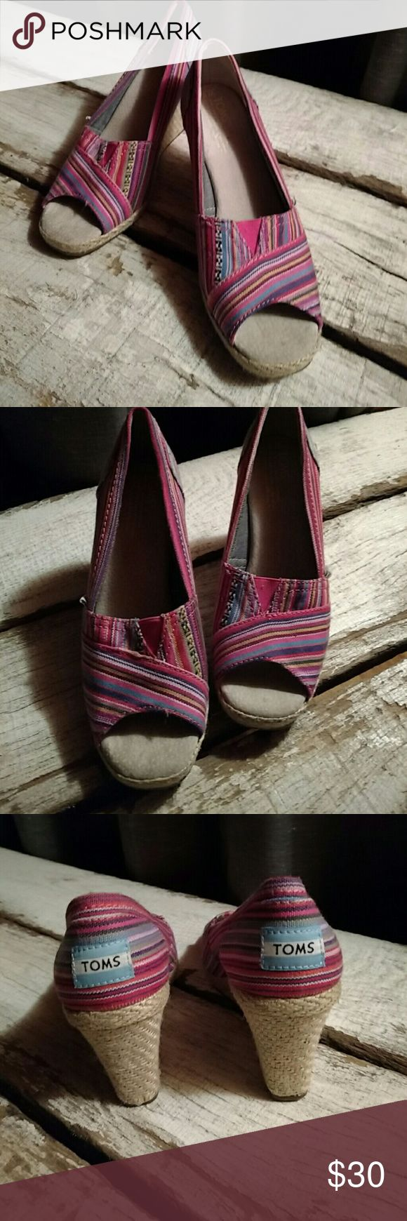 TOMS Wedges 🎨 Super cute and colorfulTom's wedges. Great for spring and summer. Open toe. Burlap bottoms Worn maybe once. No noticeable wear to insides, toes, or bottoms. Mostly pink with blue, white, yellow, orange striped pattern. TOMS Shoes Wedges