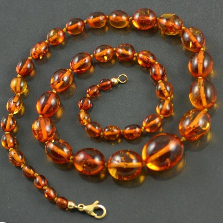 Hand knotted graduated amber beads, set to a lobster claw clasp.  Size : 51cm X 16mm - 5mm, weight : 23.9g.  Period : Modern Jewellery ( 1960s onwards ).  All items are presented in one of our beautiful signature boxes.Free worldwide delivery on all purchases.