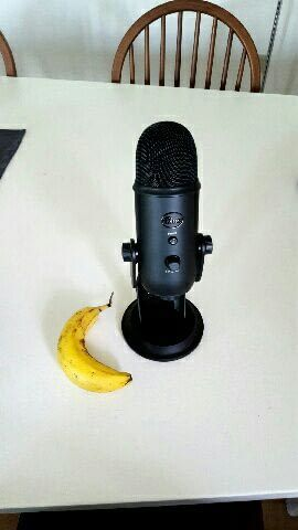Blue Yeti microphone with a banana for scale