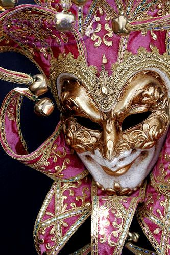 Mardi Gras mask in gold and pink