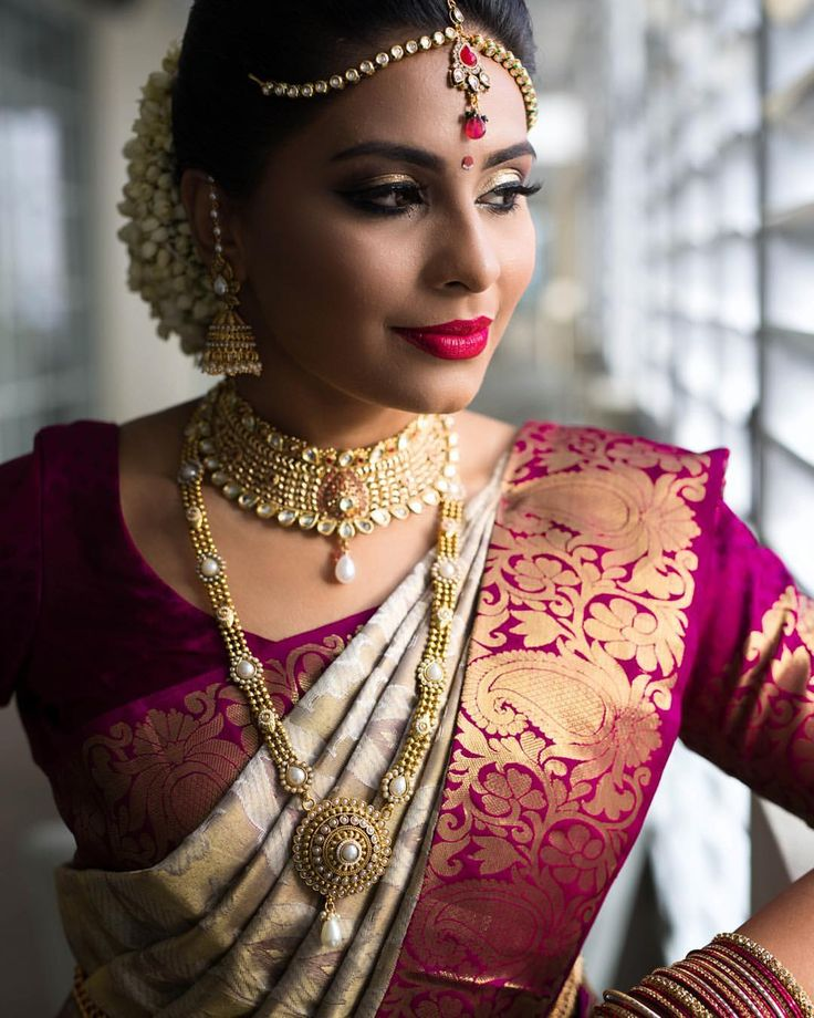 South Indian bride. Gold Indian bridal jewelry.Temple jewelry. Jhumkis.Cream white and purple silk kanchipuram sari.Braid with fresh flowers. Tamil bride. Telugu bride. Kannada bride. Hindu bride. Malayalee bride.Kerala bride.South Indian wedding.