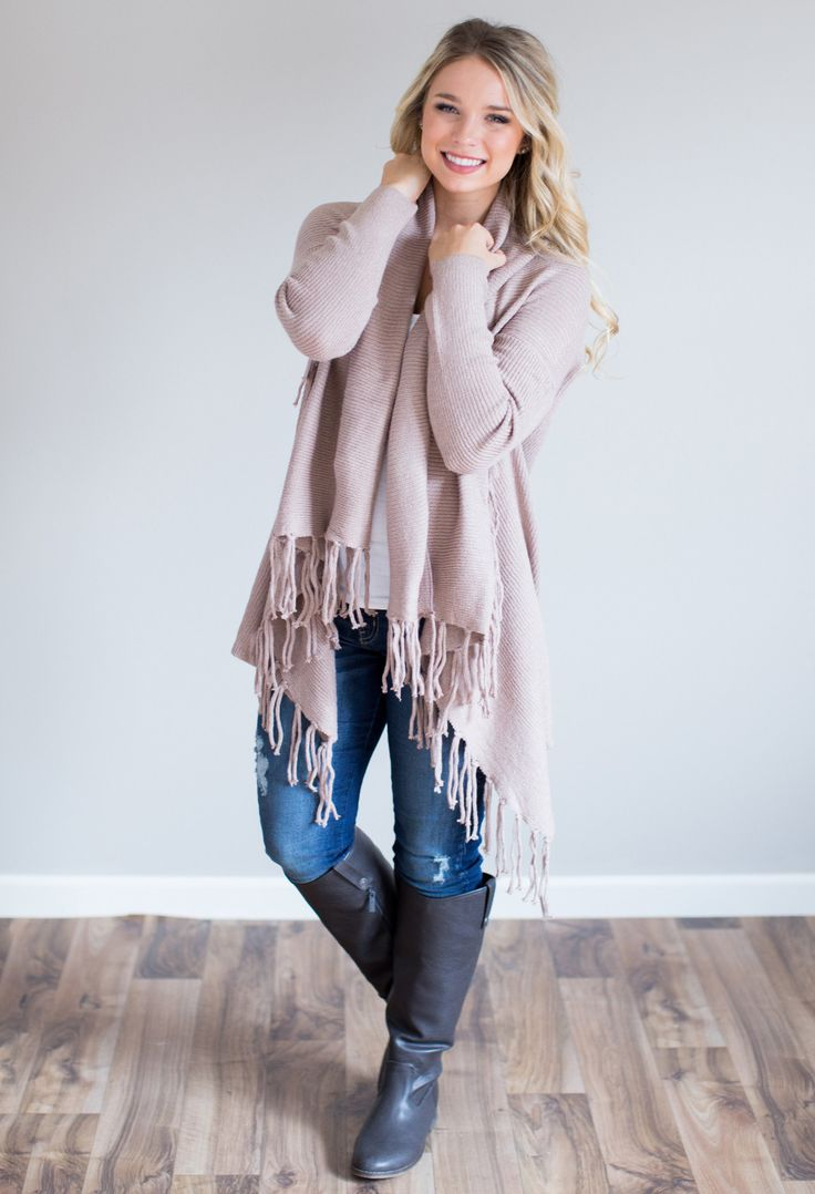 Cozy & cute cardigan with fringe accents.