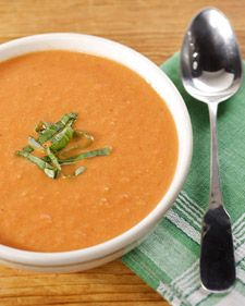 "This creamy tomato soup recipe is adapted from ""Martha Stewart's Cooking School."""