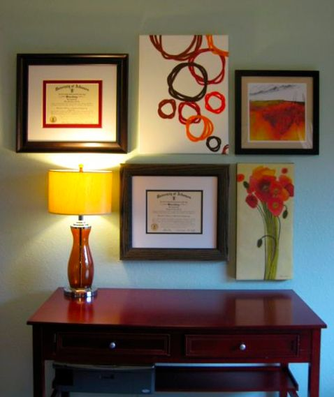 This pretty gallery wall has a wonderful mix of colors that bring out the complimentary matting tones perfect for school colors of the framed diplomas