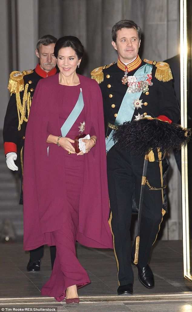 Mary is pictured alongside her husband Crown Prince Frederik, who was also  impeccably dressed in his Danish military garb