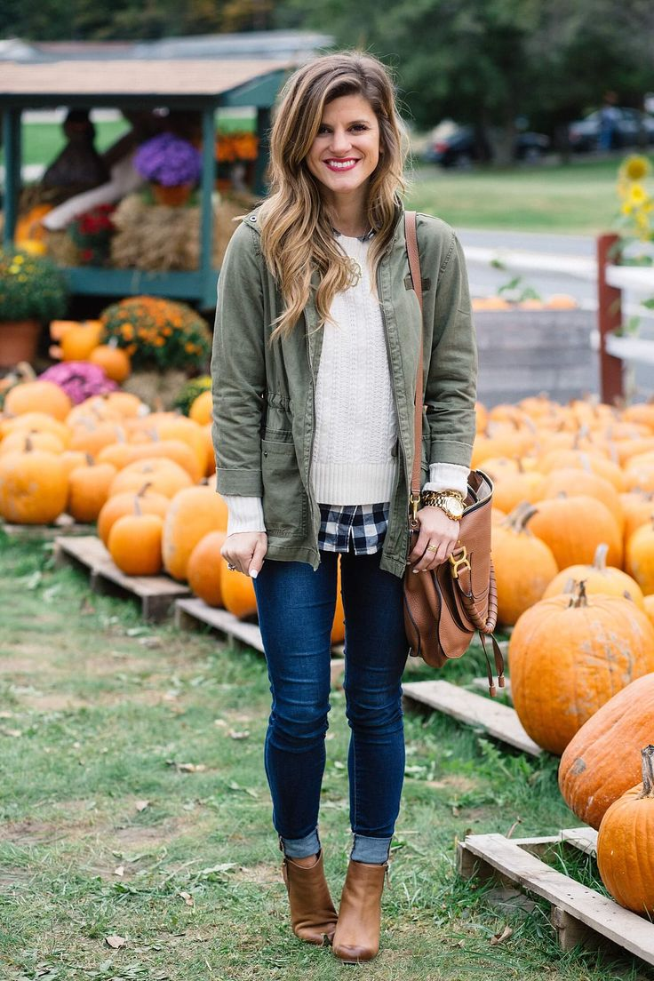 fall outfit, olive green military jacket, cable knit sweater with gingham shirt underneath, layered sweater and gingham button up shirt, rolled up jeans and booties, jeans and booties, utility jacket outfit, cognac ankle booties, monogram necklace, chloe ran bag, cute fall casual outfit