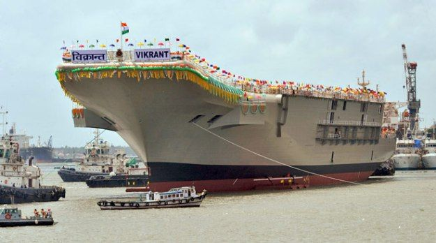 """India's indigenous carrier Vibrant during its initial 2013 launching.  India's long-delayed carrier is set to enter the water next week while the government of Prime Minister Narendra Modi government has approved more money for development of the second indigenous carrier, according to local press reports.  The 40,000-ton INS Vikrant is set to launch from the Cochin Shipyard in the southwest on May 28 following a dry dock period after the initial launch ceremony of the ship in 2013.  """"All…"""