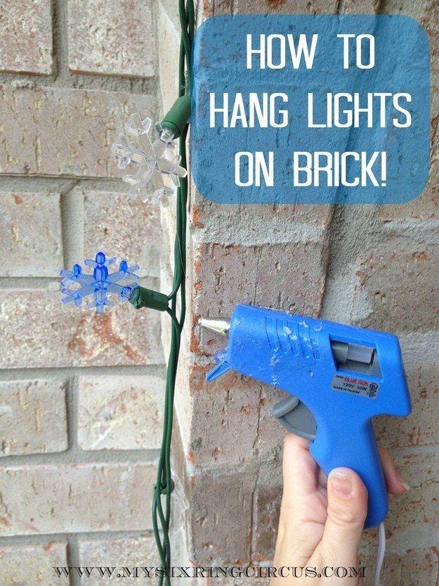 Use hot glue to hang lights on brick.   51 Life-Saving Holiday Hacks That Are Borderline Genius