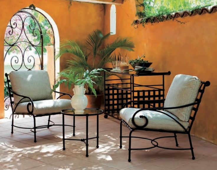 Elegant Cushioned Club Chairs From The Florentine Collection By Brown Jordan.  Beautiful Architecture.