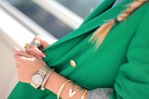 Green Blazer, gold accessories.