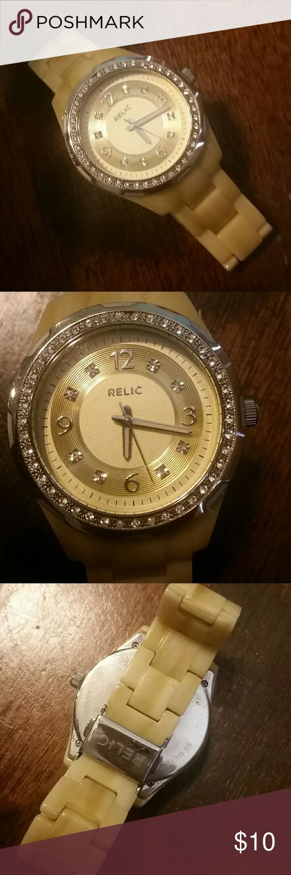 💜💙💚 Bigger Bundles Save More!!! 💚💙💜 Water resistant Relic watch with a shiny bamboo looking band, barely worn  💜💙💚 Bigger Bundles Save More!!! 💚💙💜 💜 10% off 2 or more... 💙 15% off 3 or more...  💚 20% of 4 or more... 💜 25% off 5 or more!! Relic Accessories Watches