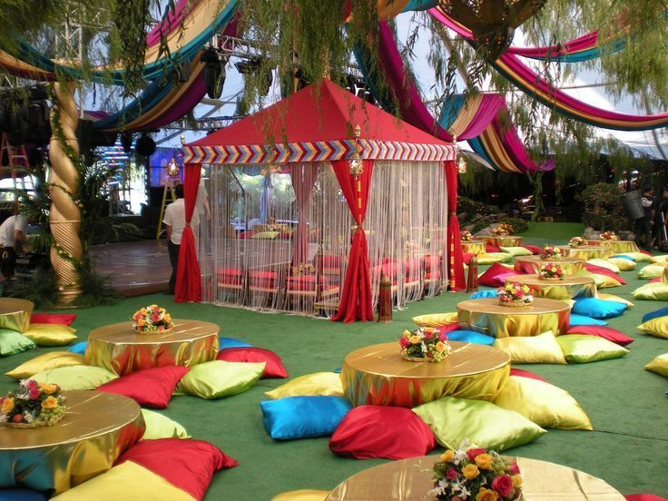 raj tents, moroccan theme, colorful, party, cabana   I love all the floor pillows and the colorful curtains on the tent for this East Indian, Moroccan, or Arabian nights party