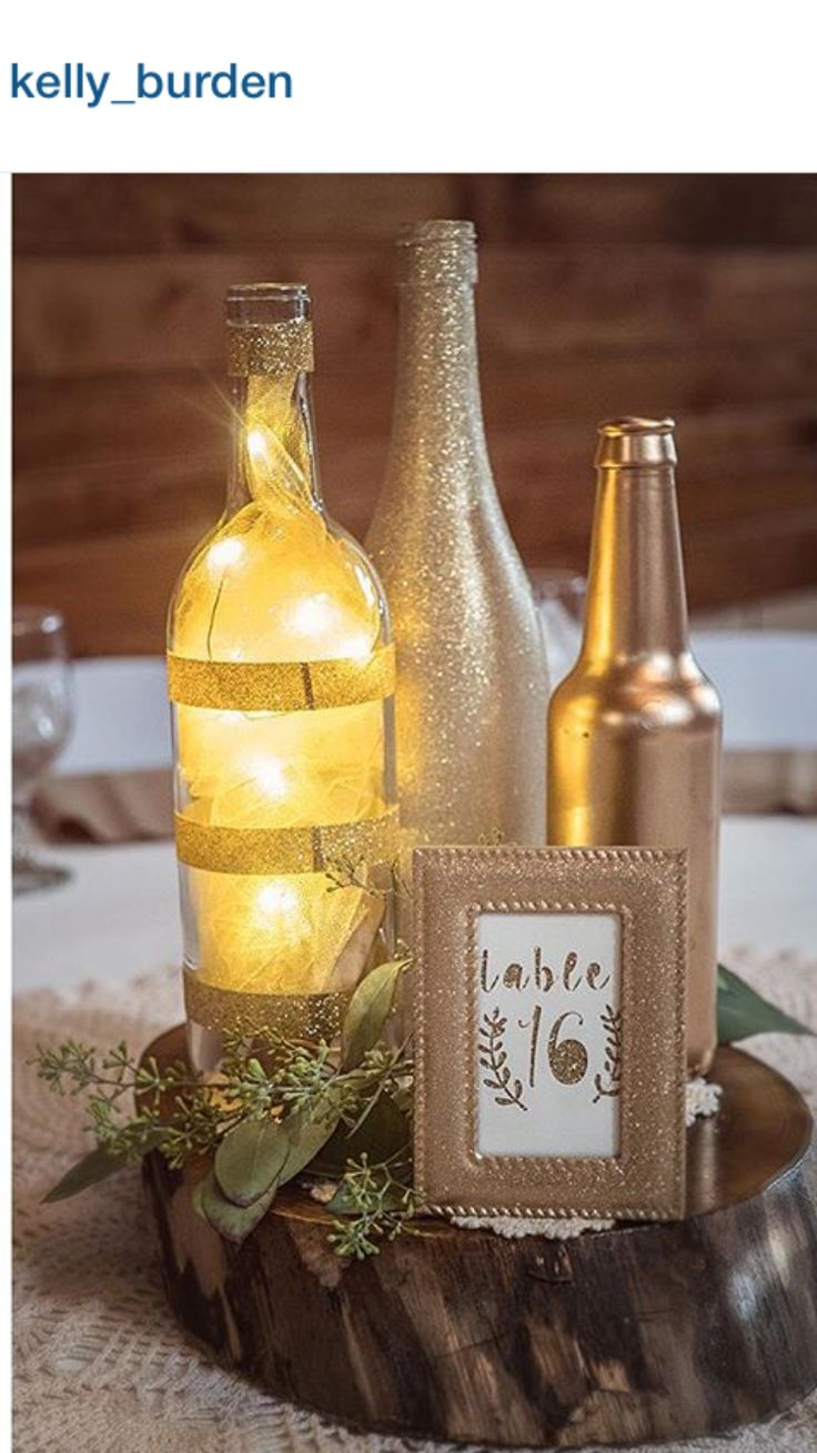 Gold centerpieces, DIY wedding, micro LED lights, wine bottle, beer bottle, gold glitter wedding. Wedding photography by Kelly Burden of South Bend, IN