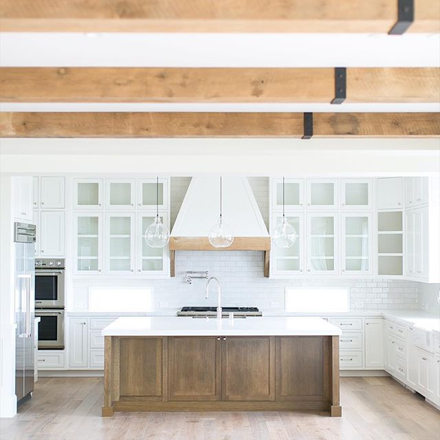 White Painted Wood Floor With Modern Cabinetry: White Backsplash, White Countertops