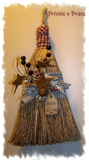 prim broom....Make a shabby chic broom by brushing white paint lightly on the whole thing OR leaving it as it is and then putting a wide lace band around it.  Decorate it with flowers and baby's breath and whatever.  Cute it would be.