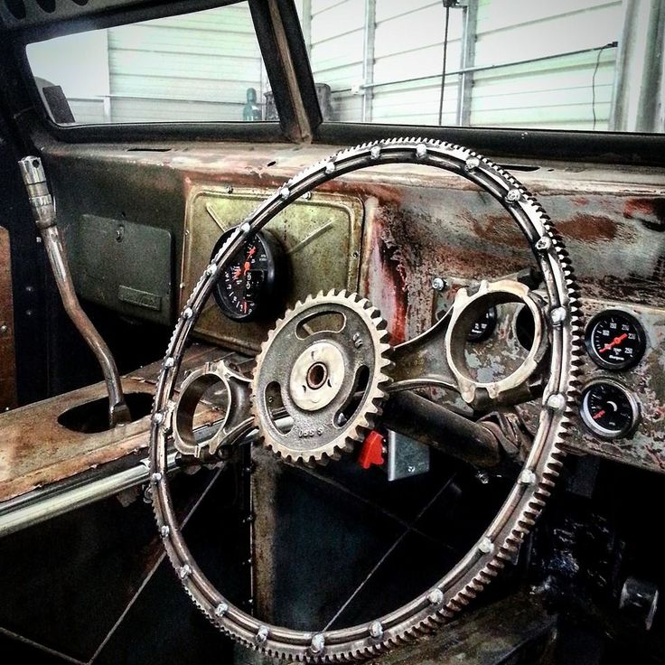 Custom ratrod steering wheel made from the teeth portion of the flexplate and piston connecting rods.