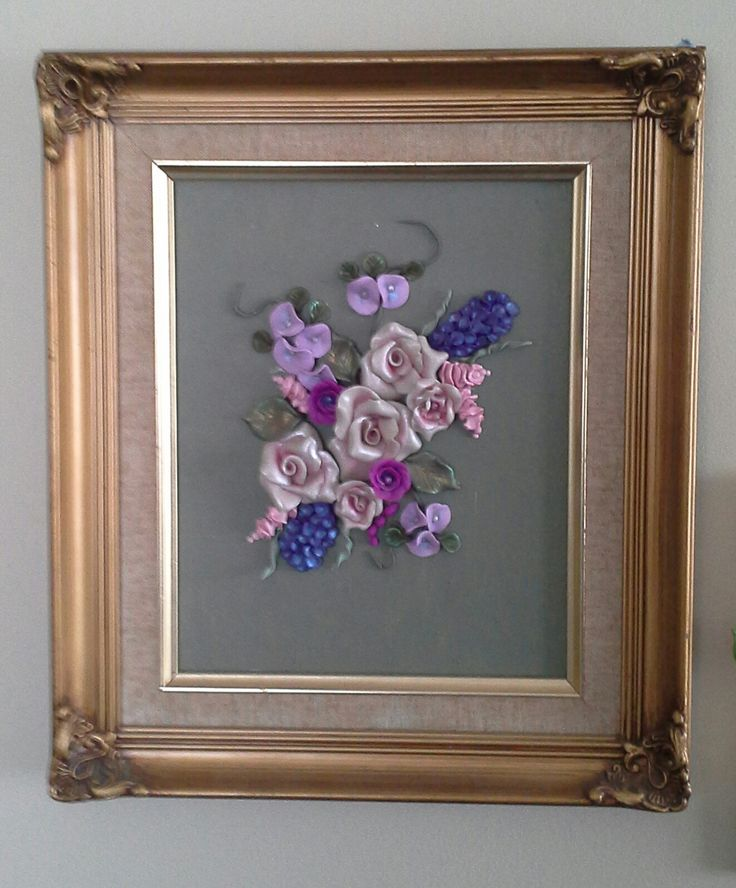 Framed flowers in polymer clay.