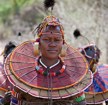 Africa | A young married Pokot woman wearing the traditional beaded ornaments of her tribe which denote her married status. The Pokot are pastoralists speaking a Southern Nilotic language. Kenya | © John Warburton-Lee