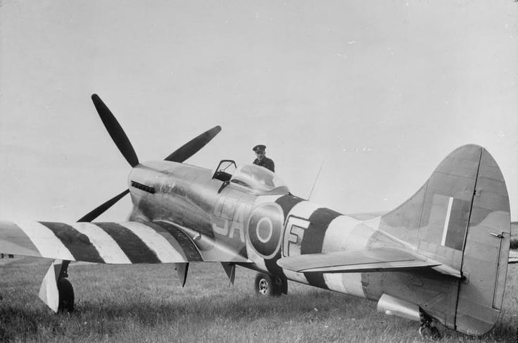 NO. 150 WING ROYAL AIR FORCE AT NEWCHURCH ADVANCED LANDING GROUND, KENT, 1944. The Commanding Officer of No. 486 Squadron RNZAF, Squadron Leader J H Iremonger, standing by the cockpit of Hawker Tempest Mark V, 'SA-F'.
