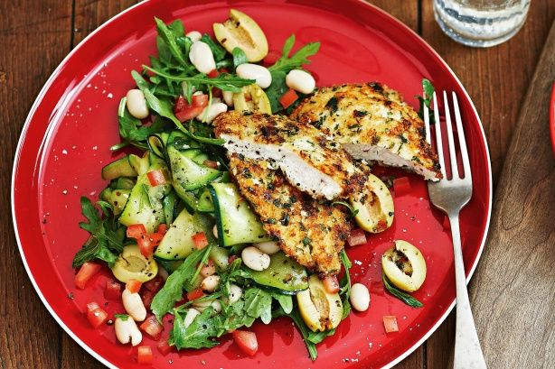 This crunchy crumbed chicken tastes fabulous paired with the fresh flavours of zucchini, mint and olives.