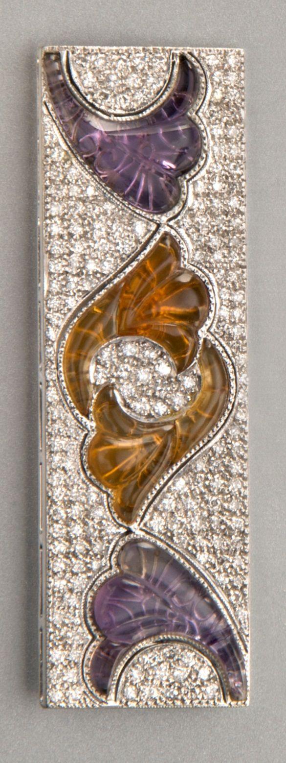 Van Cleef & Arpels - An Art Deco platinum, diamond, amethyst and topaz brooch, 1920s-1930s. 5.3 x 1.7cm. #VanCleefArpels #ArtDeco